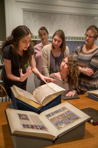 CWRU students using rare books in the Archives and Special Collections Reading Room. Photo Credit: Howard Agriesti